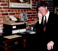 President Clinton answers the phone at New Delhi Restaurant in San Francisco. His favorite dish is Madras Tamarind Hot Curry.